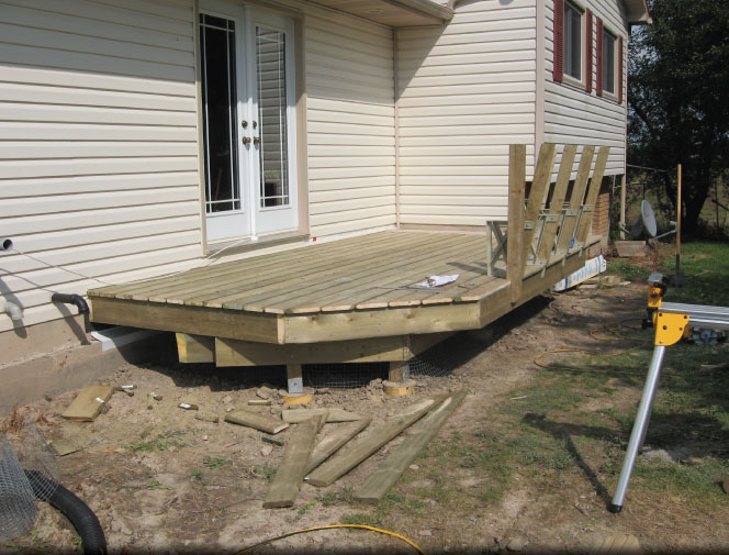 Deck boards are on and benches are started.