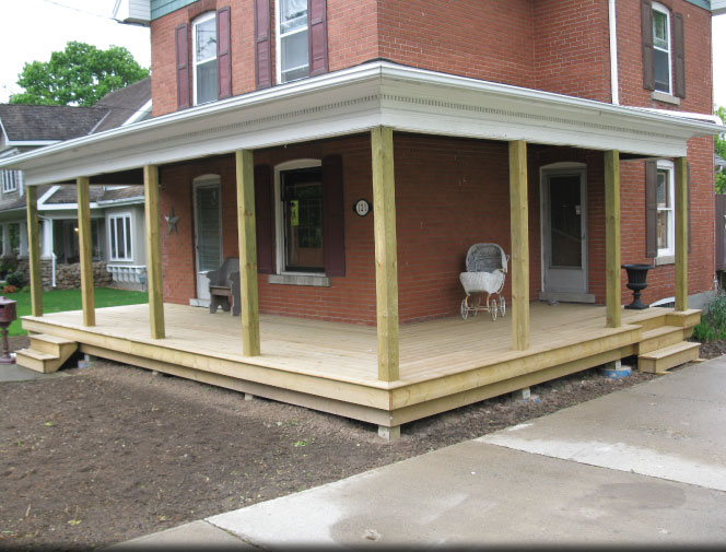 Porch roof is supported. New concrete piers, posts & decking is installed.