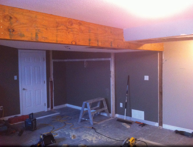 Customer wanted to join the two bedrooms into a rec room. Beam was needed for load bearing wall.