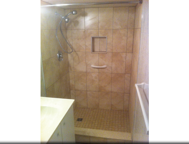 New ceramic shower stall with built in soap niche.