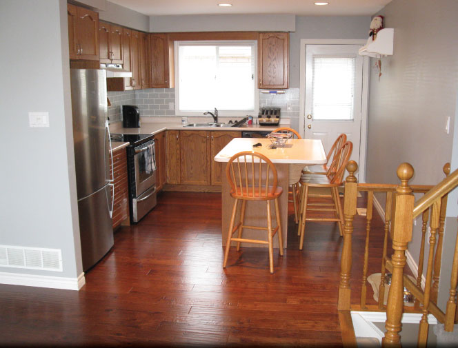 Installed new engineered hardwood flooring & re-installed kitchen cabinets.
