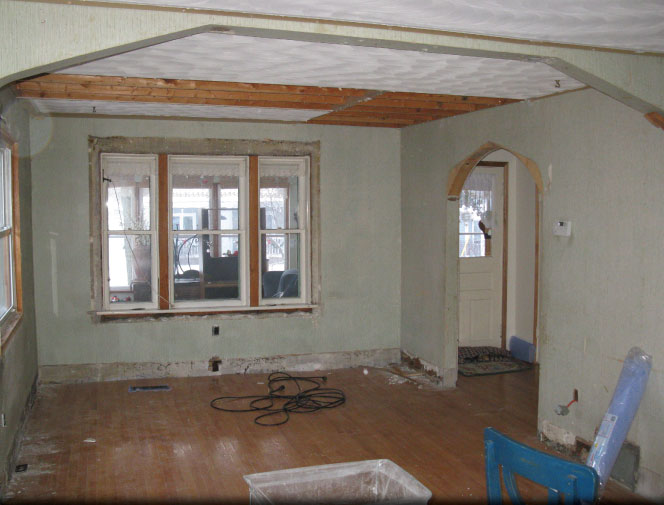 Livingroom/diningroom reno. Stripped down to bare walls. Beams added & old archways removed.